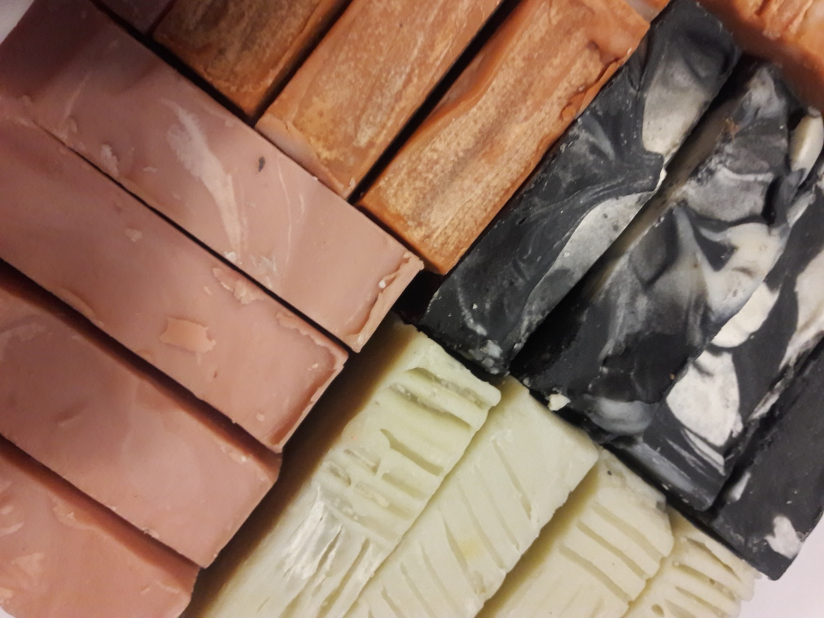 Range of handmade soaps comprising: Activated Charcoal bar, French Rose Clay Bar, French Green Clay Bar, Moroccan Red Clay Bar