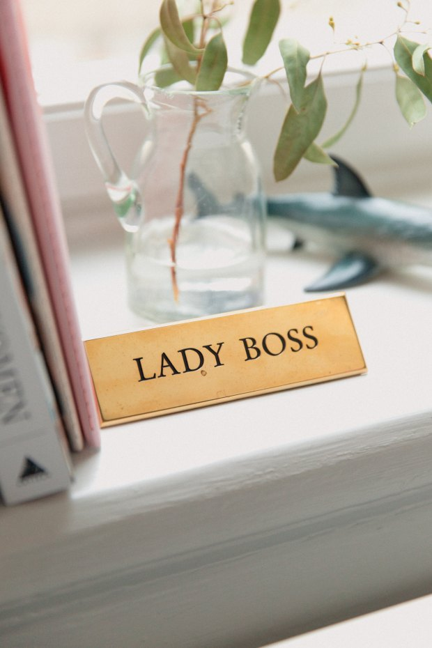 lady boss taking charge at work avoiding cliques.